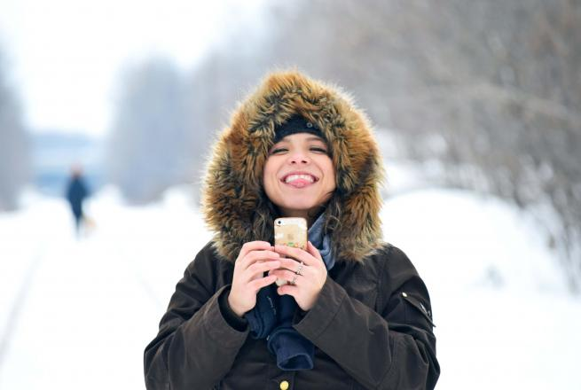 girl sticking tongue out in winter